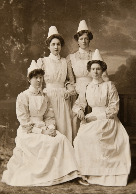 Photograph of four nurses. Nurse Annie Allan 2nd from left.<br />