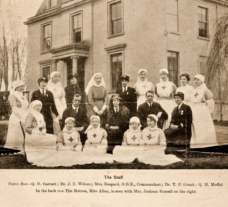 Group photograph of the staff at Caldergrove Auxiliary Hospital: Q.M. Garratt; Dr J.C. Wilson; Mrs Despard OBE, Commandant; Dr T.P. Grant; Q.M. Moffat; Matron Allan; Mrs Jackson Russell; 12 others (unnamed)<br />