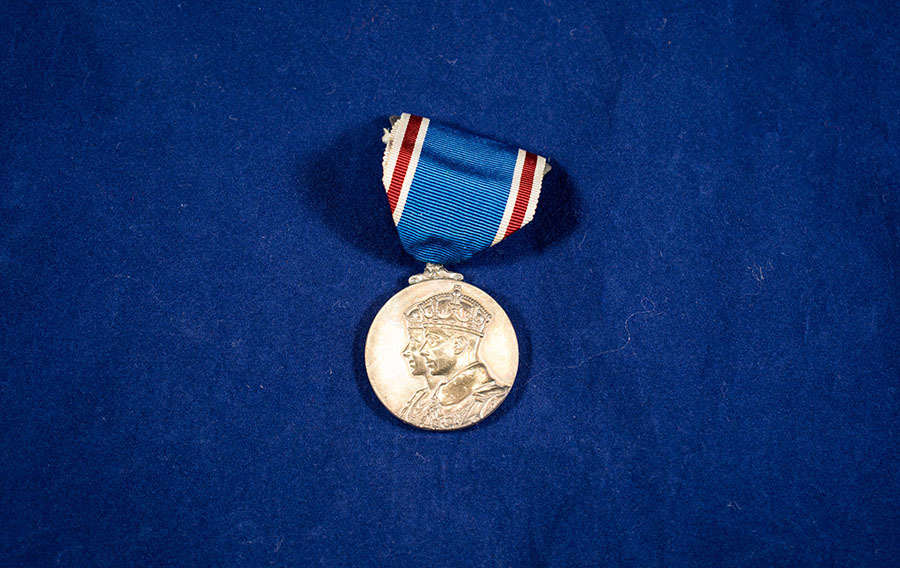 2003.66.3_george and mary coronation medal.jpg