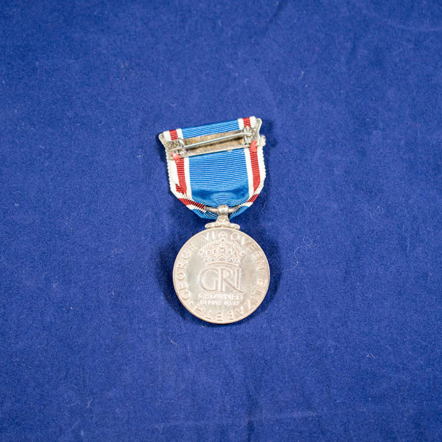 2003.66.3_george and mary coronation medal 2.jpg